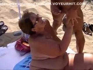 Gangbang whore blowjob cock on beach