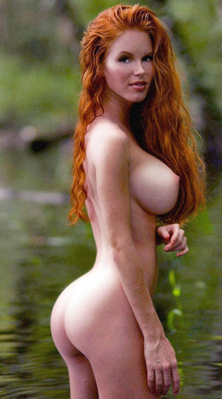 Sexy redhead with big tits