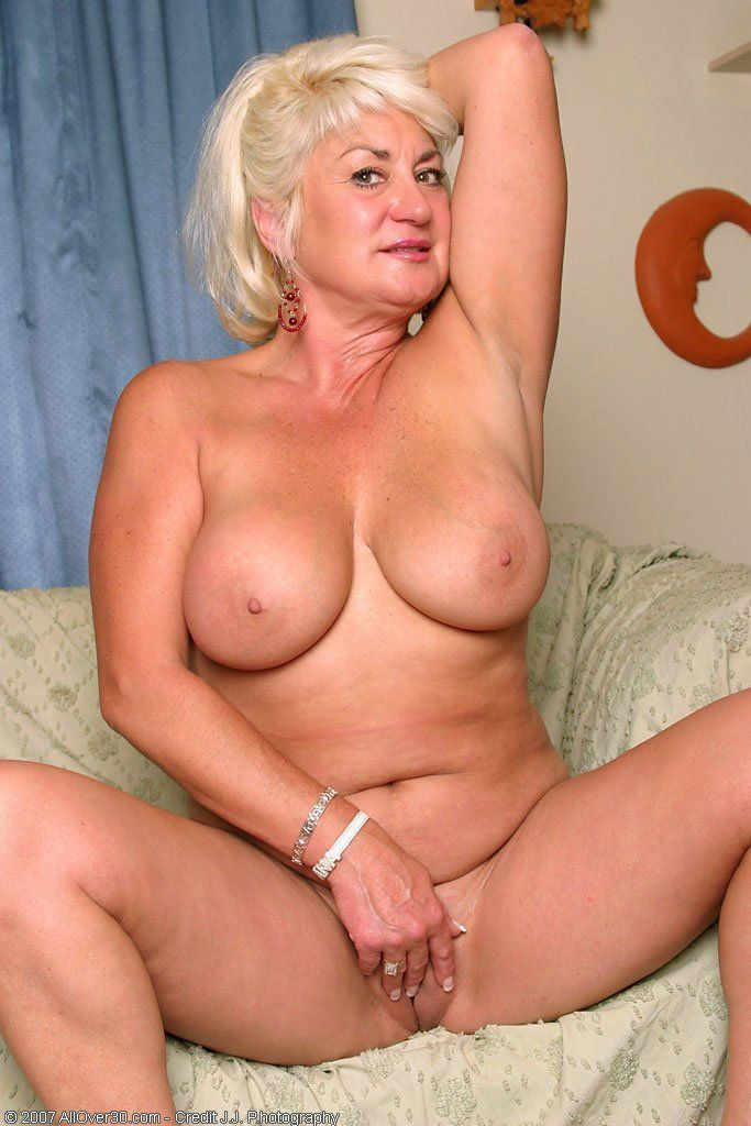 Naked mom spreads pussy