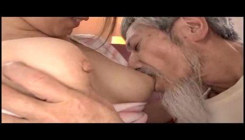 Older woman and younger guy boob sucking